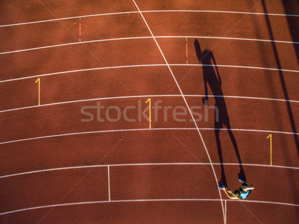 Shot of a young male athlete training on a race track  Stock photo © lightpoet