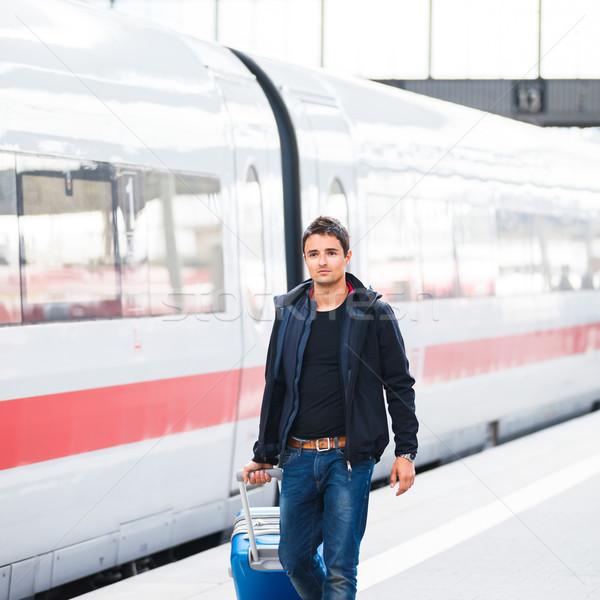 Just arrived: handsome young man walking along a platform  Stock photo © lightpoet