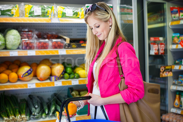 Stock photo: Beautiful young woman shopping for fruits and vegetables