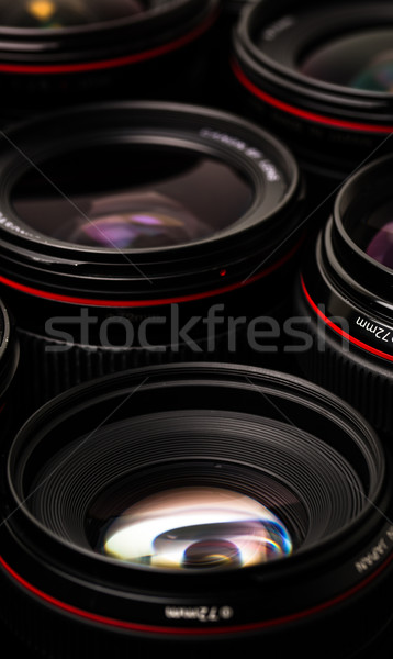 Modern camera lenses with reflections, low key image Stock photo © lightpoet