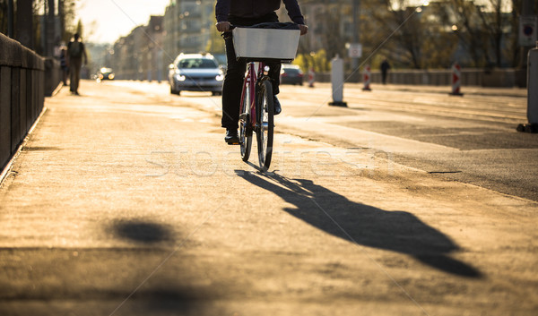 Bikers on a city street in warm evening sunlight Stock photo © lightpoet