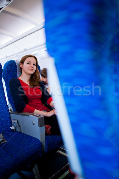 Pretty young female passenger on board of an aircraft  Stock photo © lightpoet