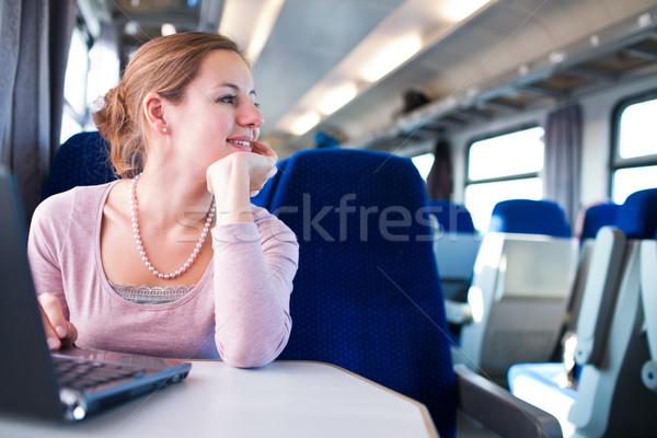 Stock fotó: Fiatal · nő · laptopot · használ · számítógép · vonat · sekély · mélységélesség