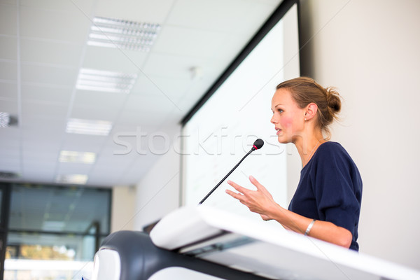 Pretty, young business woman giving a presentation Stock photo © lightpoet