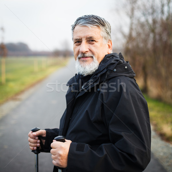 Senior man nordic walking, enjoying the outdoors Stock photo © lightpoet