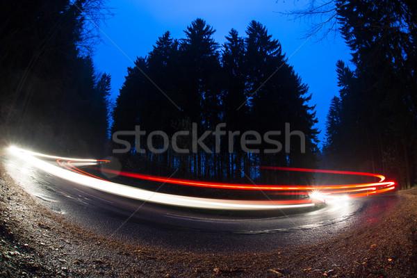 Autók gyors görbe erdő út alkonyat Stock fotó © lightpoet