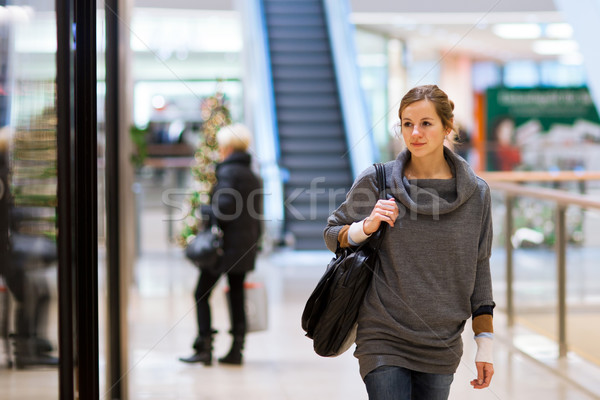 Young woman looking at store windows when shopping  Stock photo © lightpoet