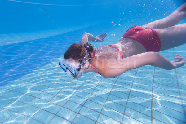 young woman swimming underwater in a pool Stock photo © lightpoet
