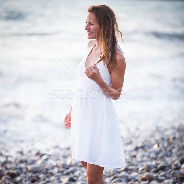 Young woman on the beach Stock photo © lightpoet