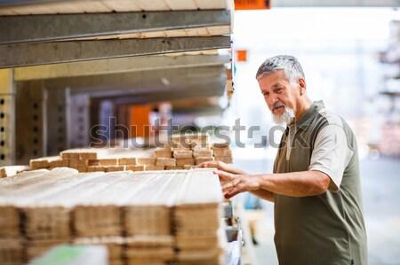 Man kiezen kopen bouw hout Stockfoto © lightpoet