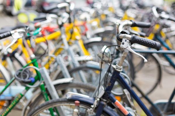 Bike rental service - Many bikes standing in bike stands Stock photo © lightpoet
