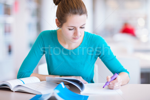 female college student in a library Stock photo © lightpoet