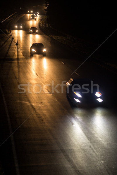 Busy highway at night with cars of commuters going home Stock photo © lightpoet