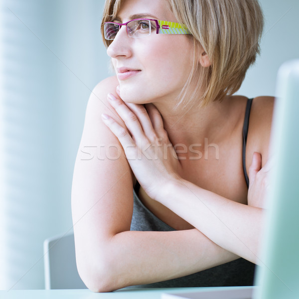 Portrait of a young woman pensively looking out of the window Stock photo © lightpoet