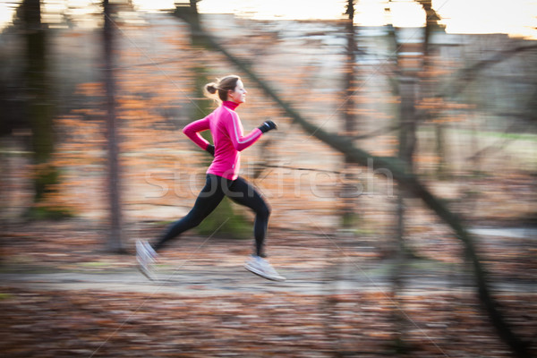 young woman running outdoors in a city park Stock photo © lightpoet