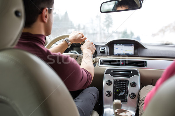 Young man driving a car with his hands on the steering wheel Stock photo © lightpoet