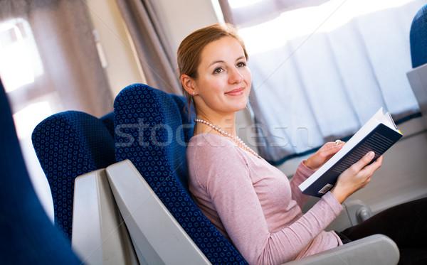 Fiatal nő olvas könyv vonat üzlet számítógép Stock fotó © lightpoet