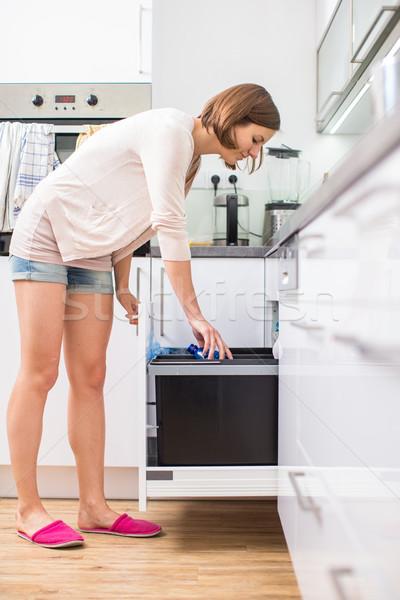Fiatal nő modern konyha nő étel boldog Stock fotó © lightpoet