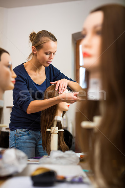 Pretty female hairdresser/haidressing apprentice/student Stock photo © lightpoet