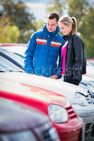 Young couple choosing the right car for them Stock photo © lightpoet