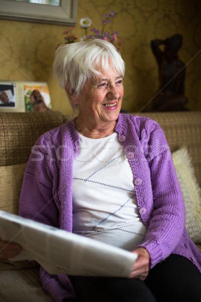 Senior woman reading morning newspape Stock photo © lightpoet