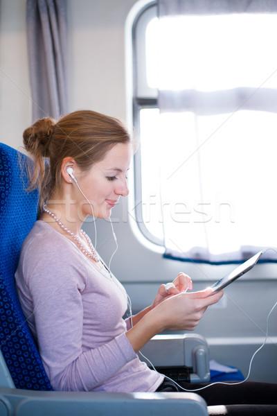 Fiatal nő táblagép utazó vonat üzlet boldog Stock fotó © lightpoet