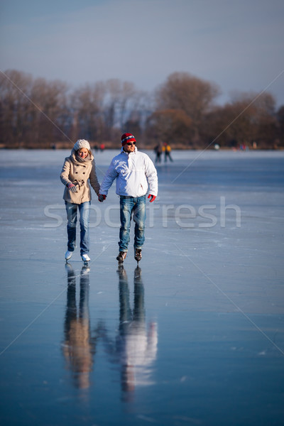 çift buz pateni açık havada gölet güneşli kış Stok fotoğraf © lightpoet