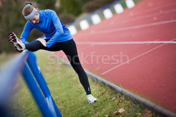 Young woman stretching before her run Stock photo © lightpoet
