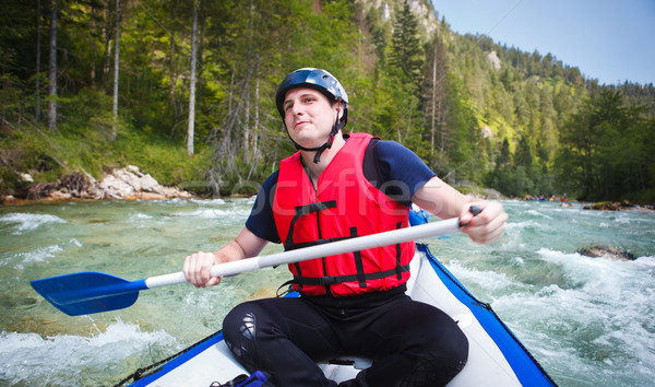 Rafting joven balsa barco hombre Foto stock © lightpoet