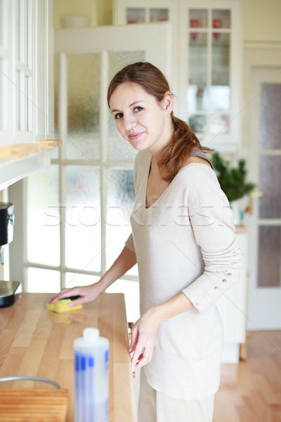 Genç kadın ev işi temizlik mutfak ev kız Stok fotoğraf © lightpoet