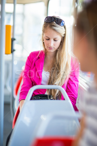 Pretty, young woman on a streetcar/tramway Stock photo © lightpoet