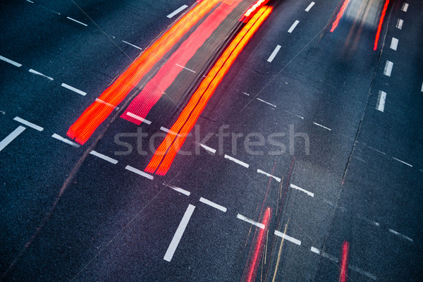 Motion blurred city road traffic (color toned  image) Stock photo © lightpoet