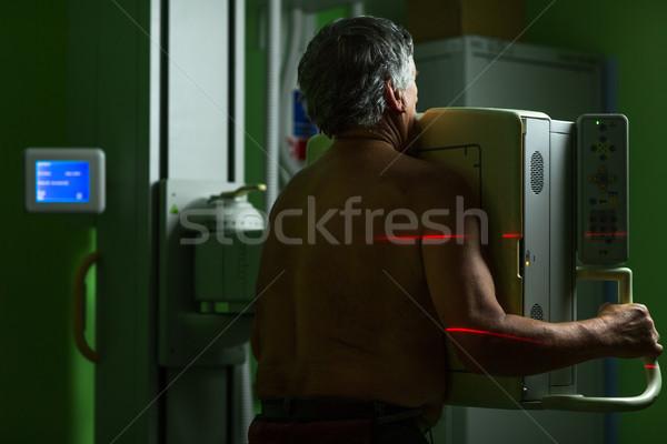 Senior male patient undergoing an X-ray examination Stock photo © lightpoet