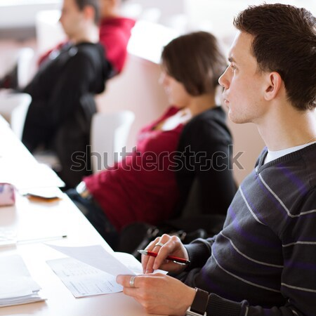 young, handsome male college student sitting in a classroom Stock photo © lightpoet