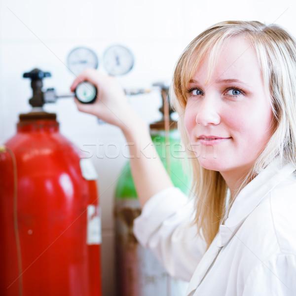 Closeup of a female researcher/chemistry student Stock photo © lightpoet