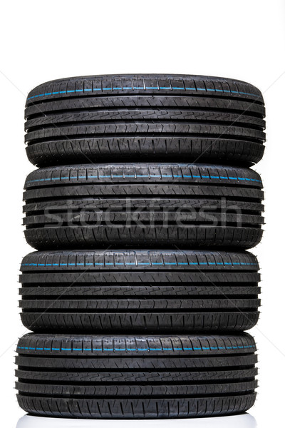 Stack of brand new high performance car tires on clean high-key  Stock photo © lightpoet