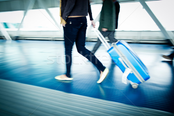 People with their suitcases walking along a corridor Stock photo © lightpoet