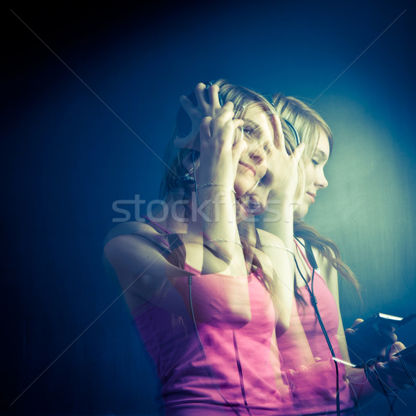 Music please! - Portrait of a pretty young woman/teenager Stock photo © lightpoet