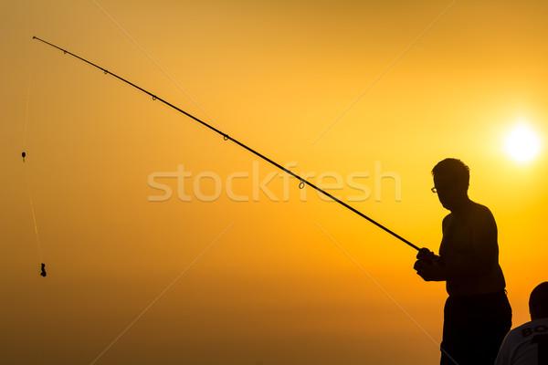 シルエット ビーチ カラフル 日没 漁師 男 ストックフォト © lightpoet
