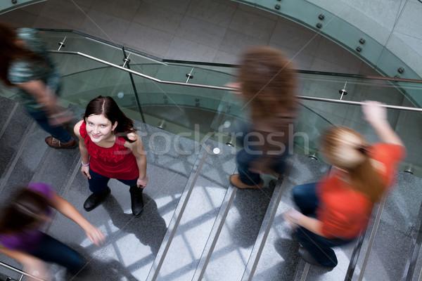 Diákok felfelé lefelé elfoglalt lépcsőfeljáró csinos Stock fotó © lightpoet