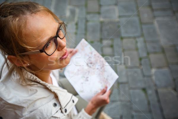 Magnifico femminile turistica mappa estero città Foto d'archivio © lightpoet