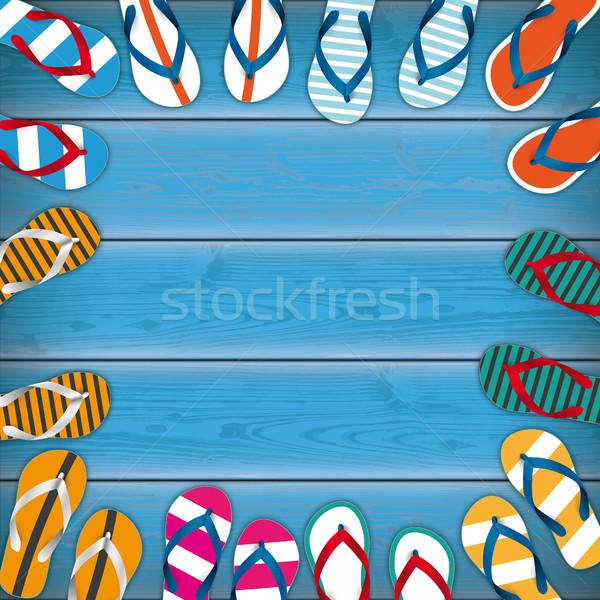 Colored Flip-Flops Wooden Background Centre Stock photo © limbi007
