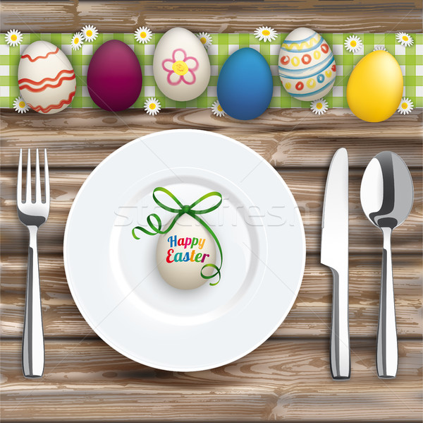 Easter Dinner Worn Wood Green Cloth Knife Fork Spoon Plate Eggs Stock photo © limbi007