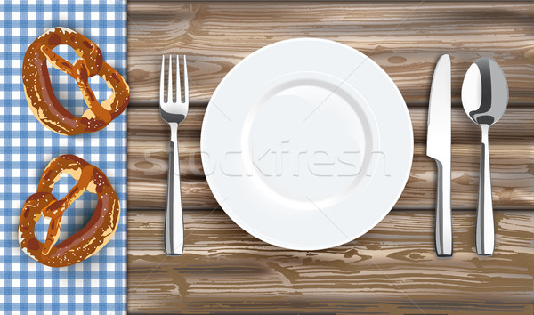 Table With Blue Table Cloth Fork Knife Plate Pretzels Stock photo © limbi007