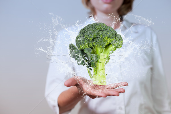 Woman Hand Broccoli Water Splashes Stock photo © limbi007