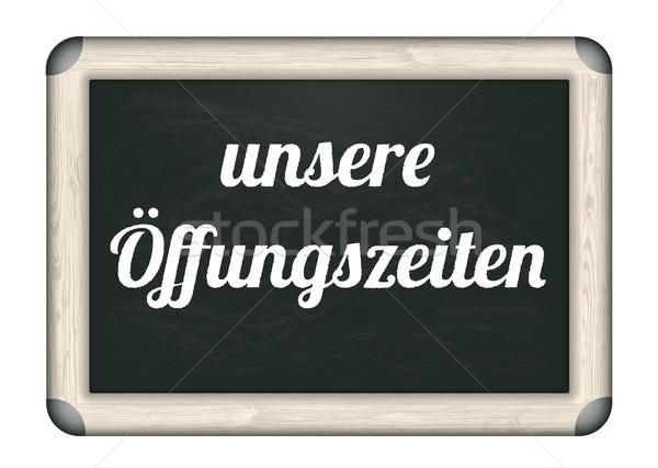 Blackboard Unsere Oeffungszeiten Stock photo © limbi007