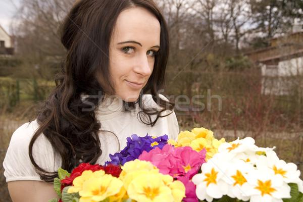 Menina cabelo preto jardim mãos mulheres Foto stock © limbi007