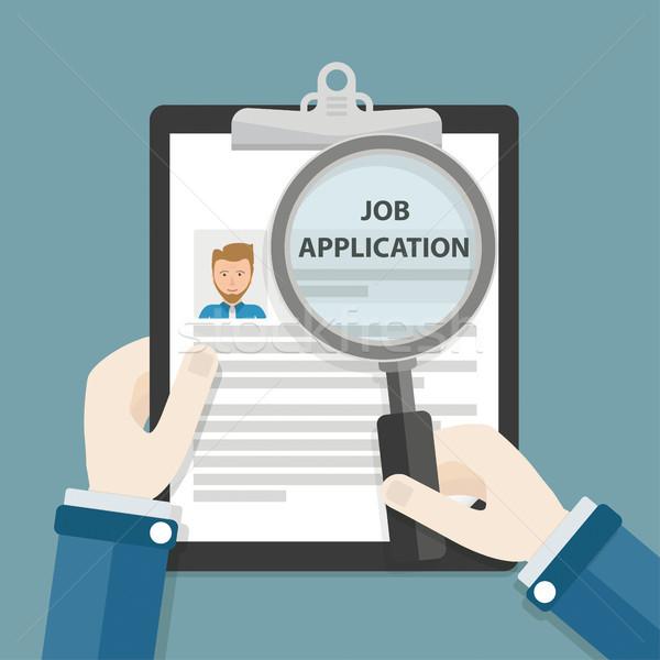 Hands Clipboard Job Application Loupe Stock photo © limbi007