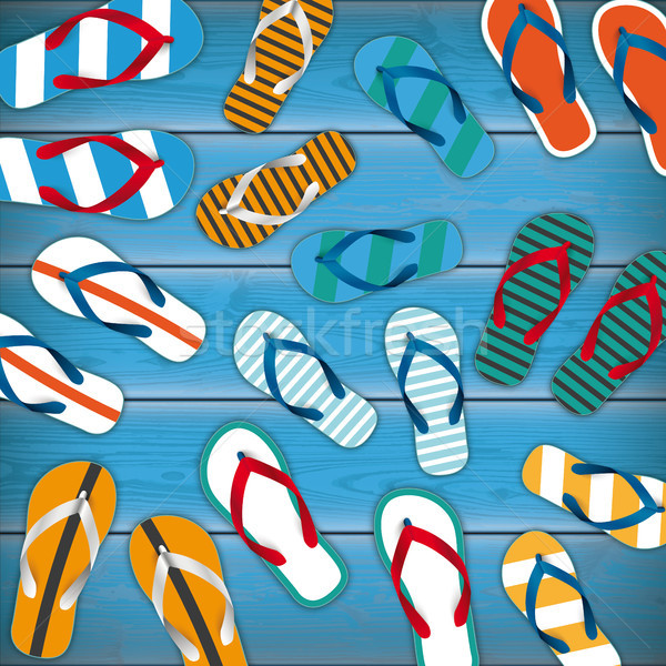 Colored Flip-Flops Wooden Background Stock photo © limbi007