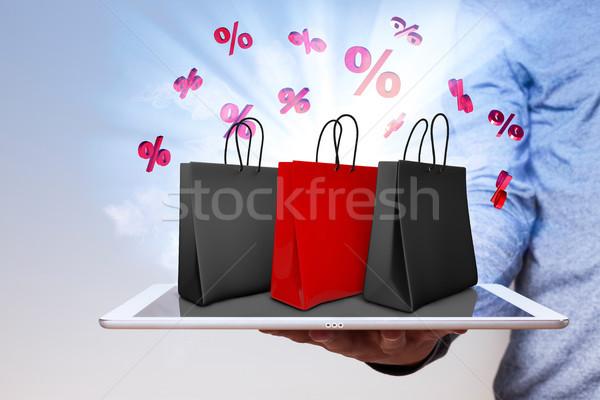 Man Tablet Shopping Bags Red Percents Stock photo © limbi007